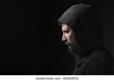 Young bearded man in studio with hood
