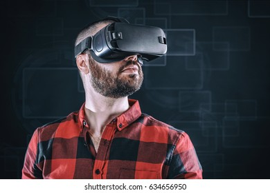 Young bearded man wearing virtual reality glasses