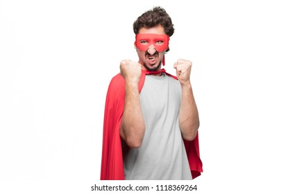 Young bearded super hero with an angry, aggressive and menacing pose, ready for the fight, showing fists furiously and belligerently.