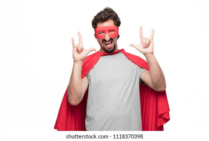 Young bearded super hero singing rock, dancing, shouting, gesturing in a rebellious, angry way.
