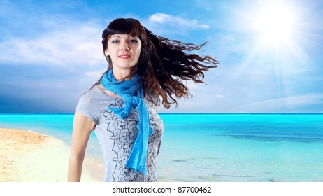Young beatiful caucasian women with hair on the wind at sunny tropical beach