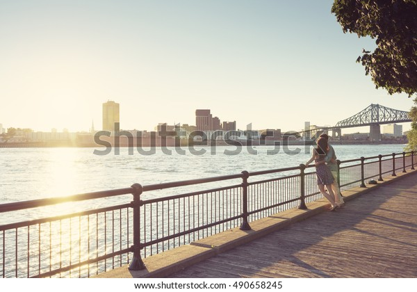 Young Beatifull Couple looking at the sunset in Montreal, Quebec, Canada