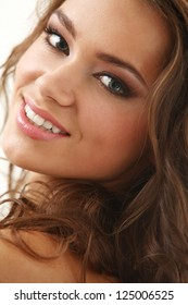 Young beautifil latino woman smiling isolated over background