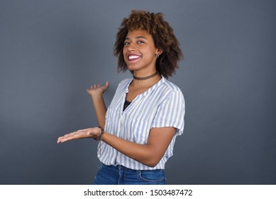 Young beautiful African American businesswoman over isolated background Inviting to enter smiling natural with open hands. Welcome sign.