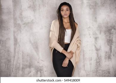 Young beautiful african american girl. Female model posing in studio.