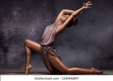 Young beautiful african american woman dancing, sensual lady.