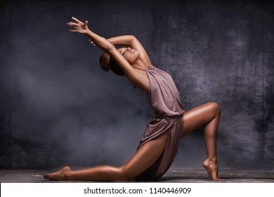 Young beautiful african american woman dancing, sensual lady.