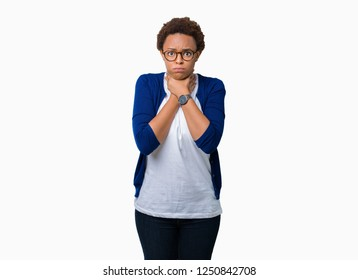 Young beautiful african american woman wearing glasses over isolated background shouting and suffocate because painful strangle. Health problem. Asphyxiate and suicide concept.