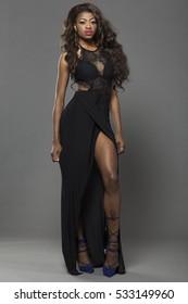 Young beautiful African girl posing in studio.