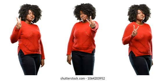 Young beautiful african plus size model raising his fingers, number two isolated over white background. Collection composition 3 figures collage