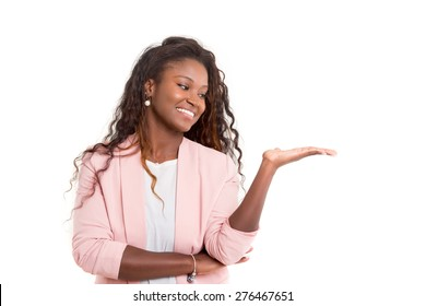 Young beautiful african woman presenting your product, isolated over white background