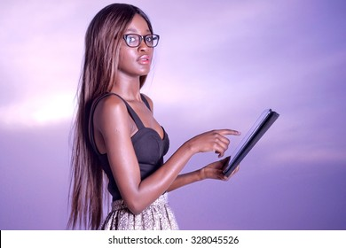 Young beautiful African woman using a tablet, Business woman using a tablet