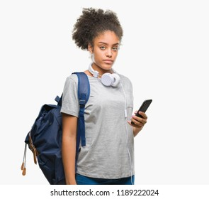 Young beautiful afro american student woman holding backpack over isolated background with a confident expression on smart face thinking serious