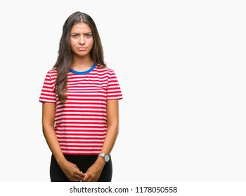 Young beautiful arab woman over isolated background skeptic and nervous, frowning upset because of problem. Negative person.