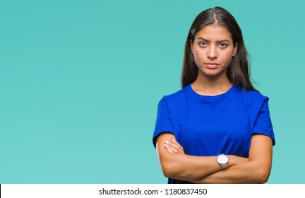Young beautiful arab woman over isolated background skeptic and nervous, disapproving expression on face with crossed arms. Negative person.