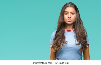 Young beautiful arab woman over isolated background with serious expression on face. Simple and natural looking at the camera.