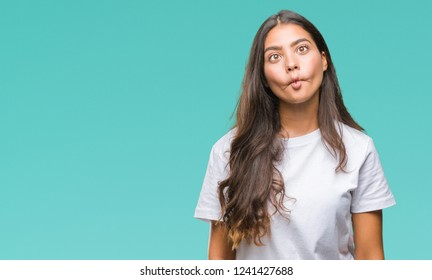 Young beautiful arab woman over isolated background making fish face with lips, crazy and comical gesture. Funny expression.