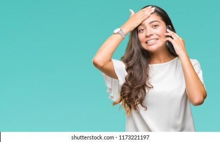 Young beautiful arab woman talking on the phone over isolated background stressed with hand on head, shocked with shame and surprise face, angry and frustrated. Fear and upset for mistake.