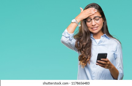Young beautiful arab woman texting using smartphone over isolated background stressed with hand on head, shocked with shame and surprise face, angry and frustrated. Fear and upset for mistake.