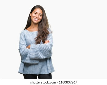 Young beautiful arab woman wearing winter sweater over isolated background happy face smiling with crossed arms looking at the camera. Positive person.
