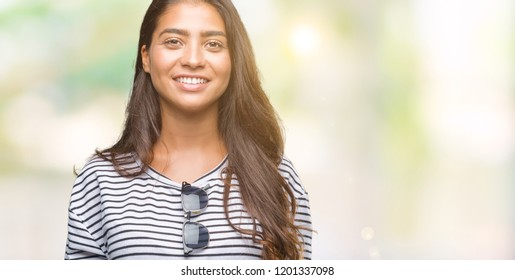 Young beautiful arab woman wearing sunglasses over isolated background with  a happy and cool smile on 2aa4a8e64b32c