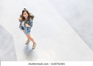 Young beautiful Asian backpack traveler, cute woman wearing hat looking up and smile, top view with copy space. Journey trip lifestyle, world travel explorer or Asia summer tropical tourism concept