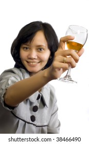 Young beautiful asian business woman celebrating her success with wine and sit on the table