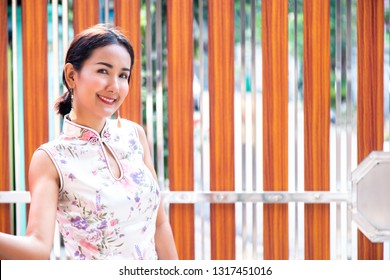 Young Beautiful Asian Girl with Qipao, Happy and Smiley Friendly.