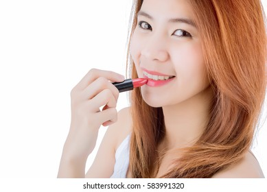 young and beautiful asian woman applying red lipstick, isolated on white background.