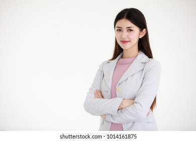Young beautiful Asian woman with black long hair standing in front of white background, self confident manner