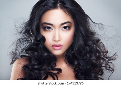 Young and beautiful asian woman with curly hair