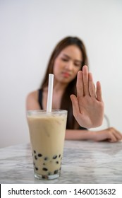Young beautiful Asian woman during dieting course rejecting to drink bubble milk tea because avoiding high calories food.