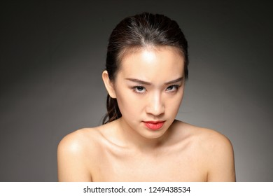 Young beautiful Asian woman facial expression