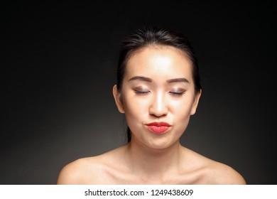 Young beautiful Asian woman facial expression
