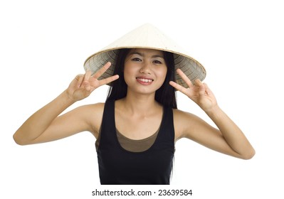 young, beautiful asian woman with hat making victory signs