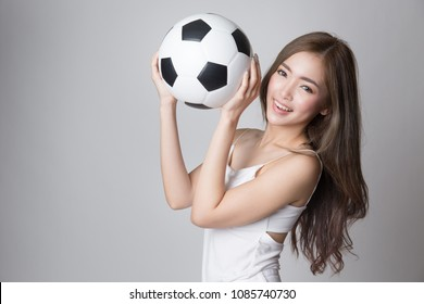 Young beautiful asian woman holding a soccer ball