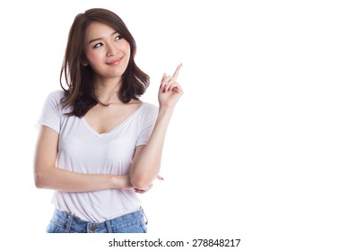 Young beautiful asian woman pointing to copyspace, isolated on white background