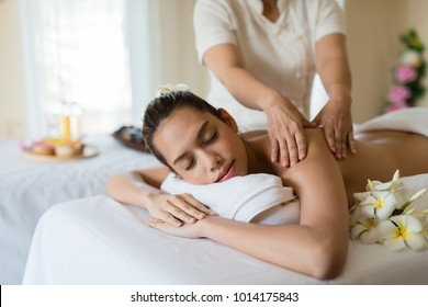 Young beautiful Asian woman relaxing in the spa massage