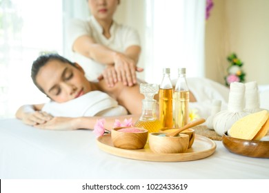 Young beautiful Asian woman relaxing with Massage and body ody care. Spa body massage treatment in the Health Spa