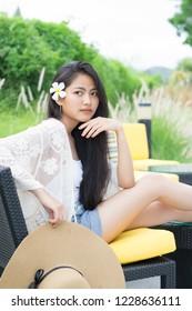 Young beautiful asian woman relaxing outdoor on a resort