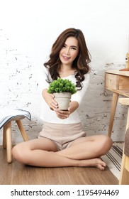 young beautiful asian woman sit down and relax in studio the room