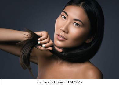 Young and beautiful Asian woman with straight black hair