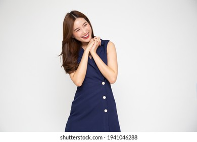 Young beautiful Asian woman surprise and delight isolated over white background, Thrilled excited concept