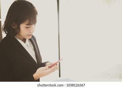 young beautiful asian woman talking on her phone with a client
