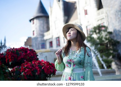 Young beautiful Asian woman tourist is traveling at French village on Bana Hills in Danang, Vietnam.