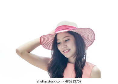 Young beautiful Asian woman wearing pink straw hat with expression of happy ,  white background