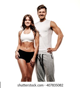Young and beautiful athletic woman and man on white background