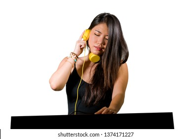 young beautiful and attractive Asian Korean DJ woman remixing music at night club wearing headphones in clubbing party and deejay  lifestyle concept isolated on white background