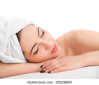 Young beautiful  attractive woman receiving facial massage and spa treatment over white background. Perfect Skin. Skincare. Young Skin