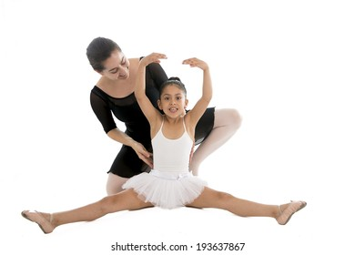 young beautiful ballerina dancing and learning from her dance teacher on a white background.
